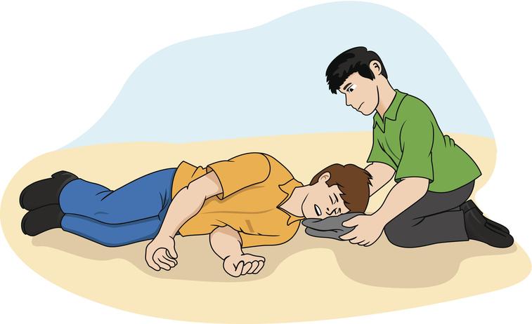 Нужно осторожно переложить человека на бок и положить что-нибудь мягкое под голову
